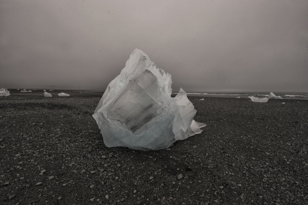 A beached iceberg at golden hour.