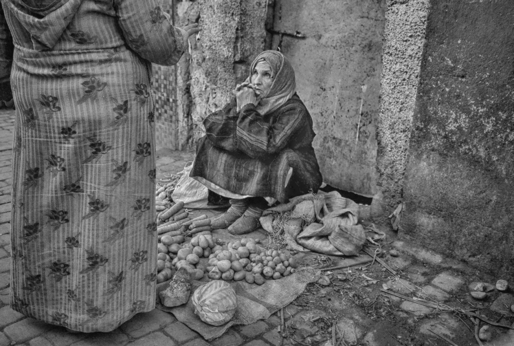 A woman sits and listens to the stories f the day