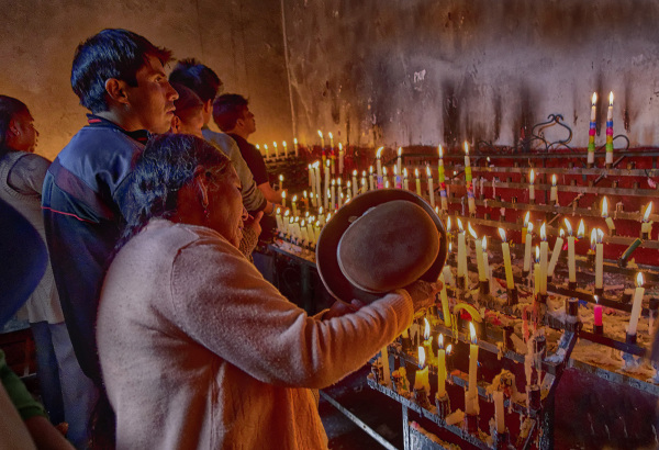 The heat from the prayer candles glowed brightly.