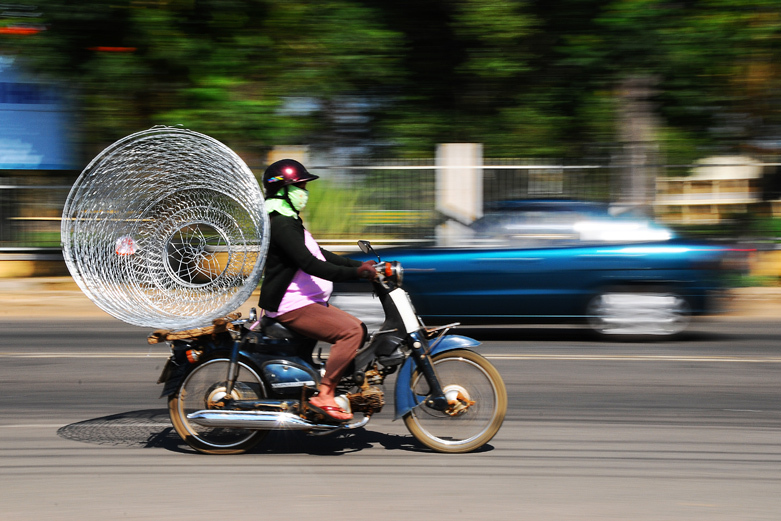 Motorcyclist with a Wire Cage