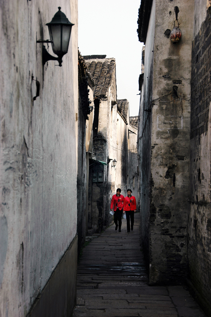 Red Coats in a Narrow Lane