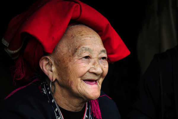 red Dzao woman elderly Sapa minority tribe Vietnam