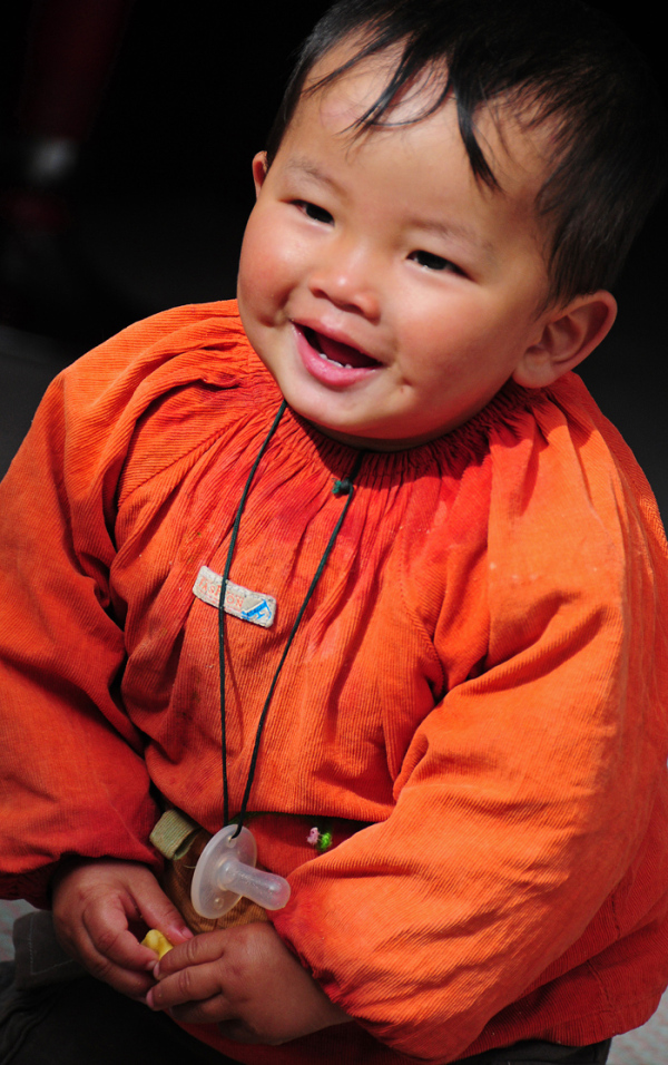 Boy in Orange Dress