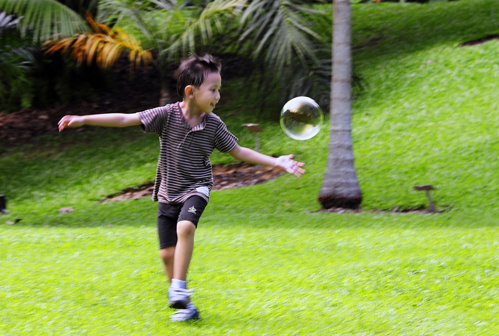 Boy Chasing Bubble