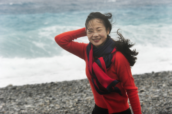 Girl at a Windy Beach
