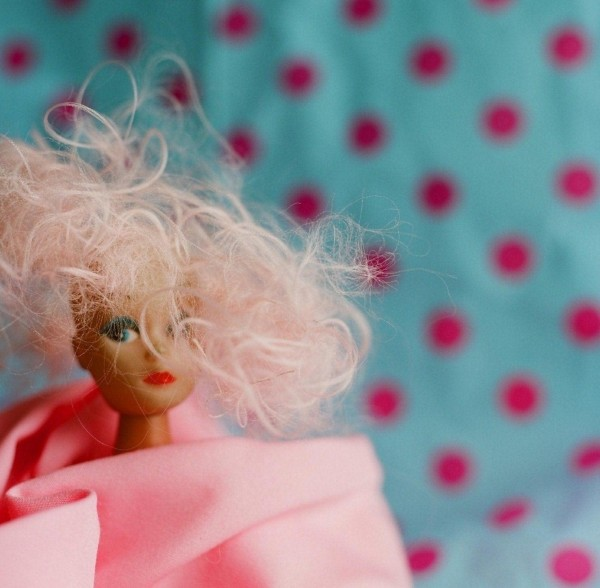 A Doll Dressed In Pink