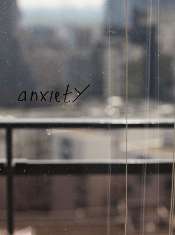 The word Anxiety written on a window...