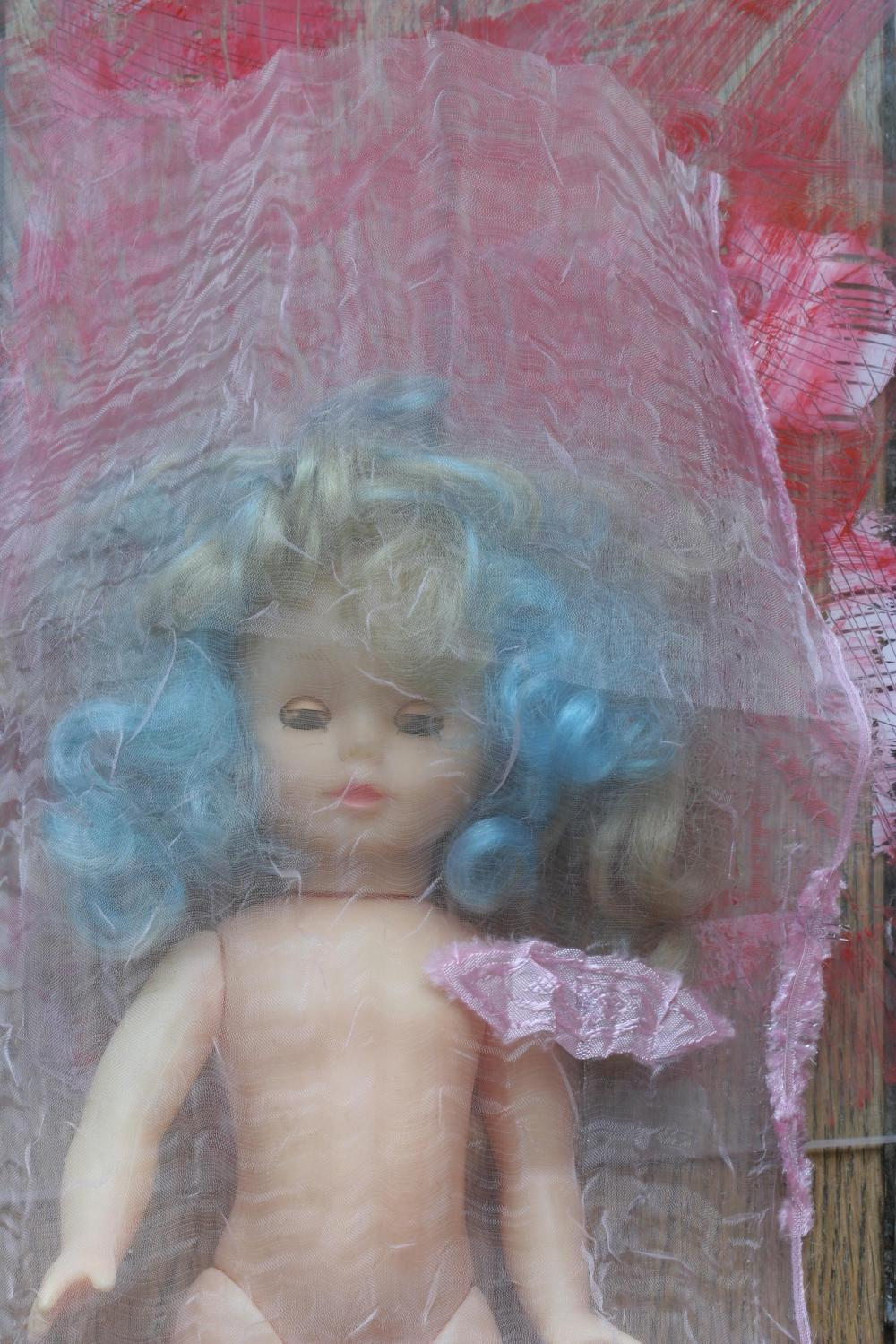 A Naked Doll under different Veils...