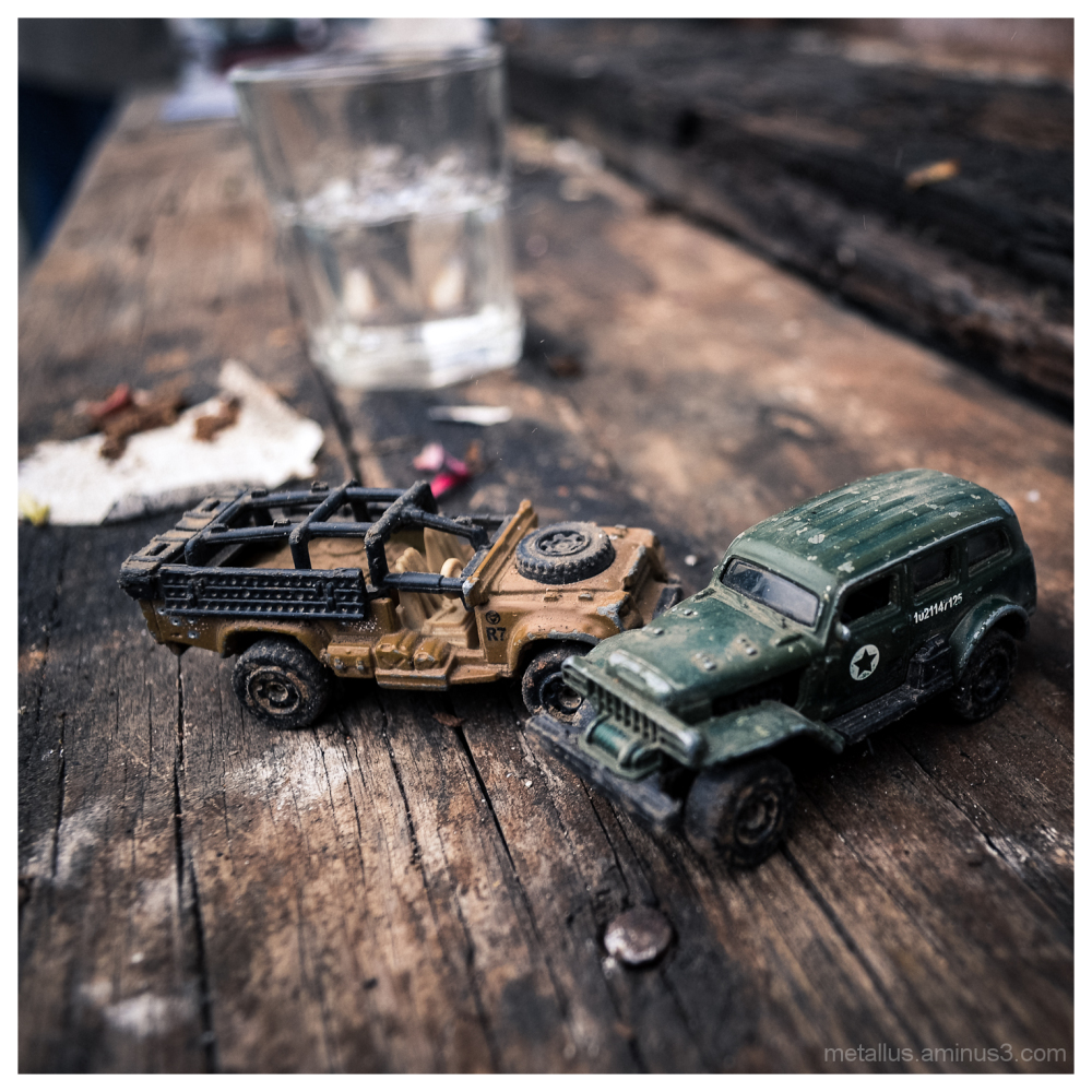 Toy cars and a glass