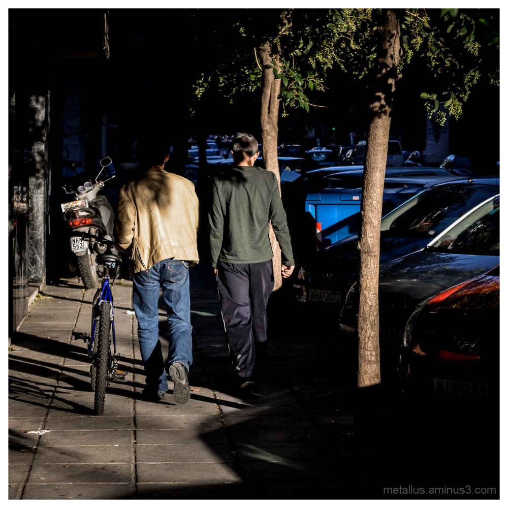 Two man walking at Thessaloniki, Greece