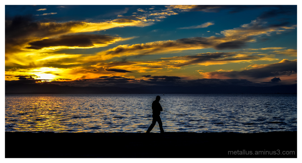 A fisherman at Thessaloniki coast boardwalk Greece
