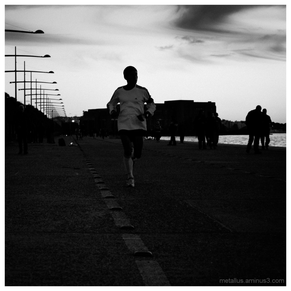 A man jogging at Thessaloniki boardwalk Greece