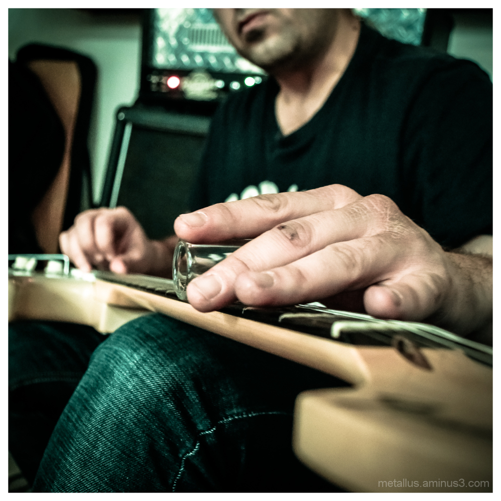 A man palying slide guitar