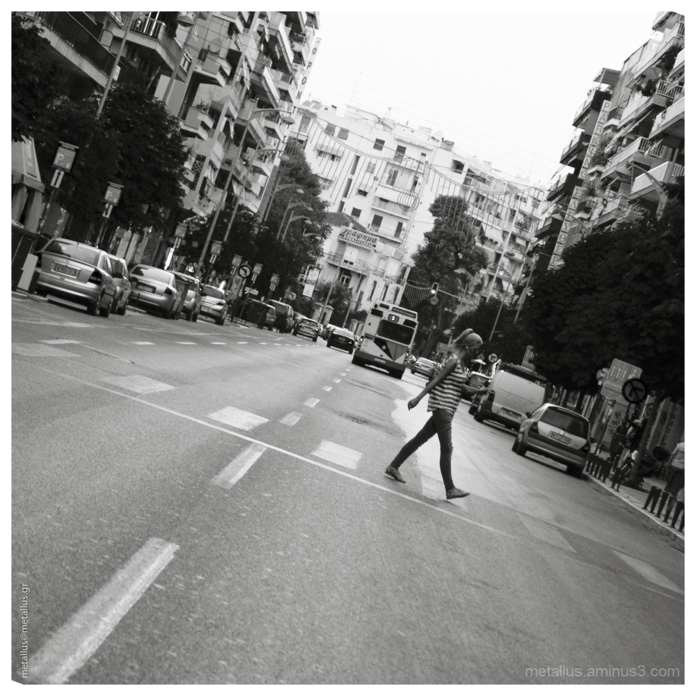 A woman crossing a street, Thessaloniki Greece