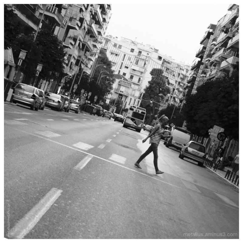 A woman crossing a street, Thessaloniki Greece