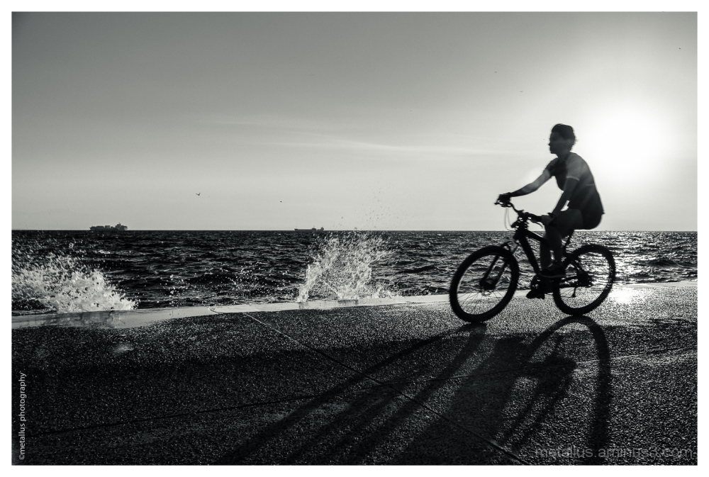 A biker at the boardwalk at Thessaloniki, Greece