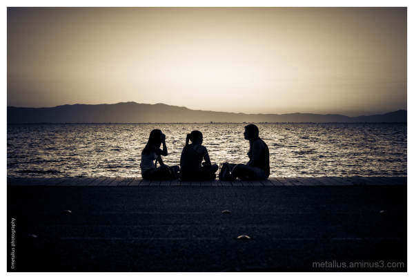 Friends at the boardwalk of Thessaloniki, Greece