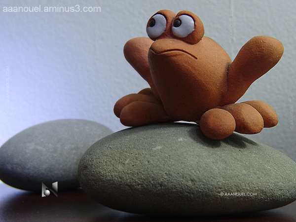 tropical frog looking stone ceramic sculpture