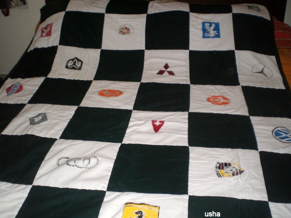 quilt handpainted with symbols of cars