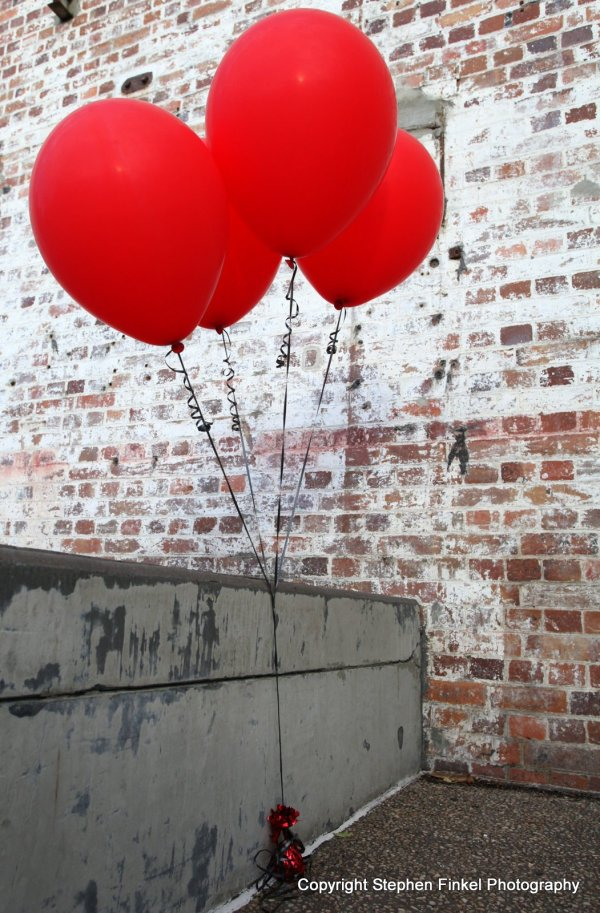 Four red Balloons