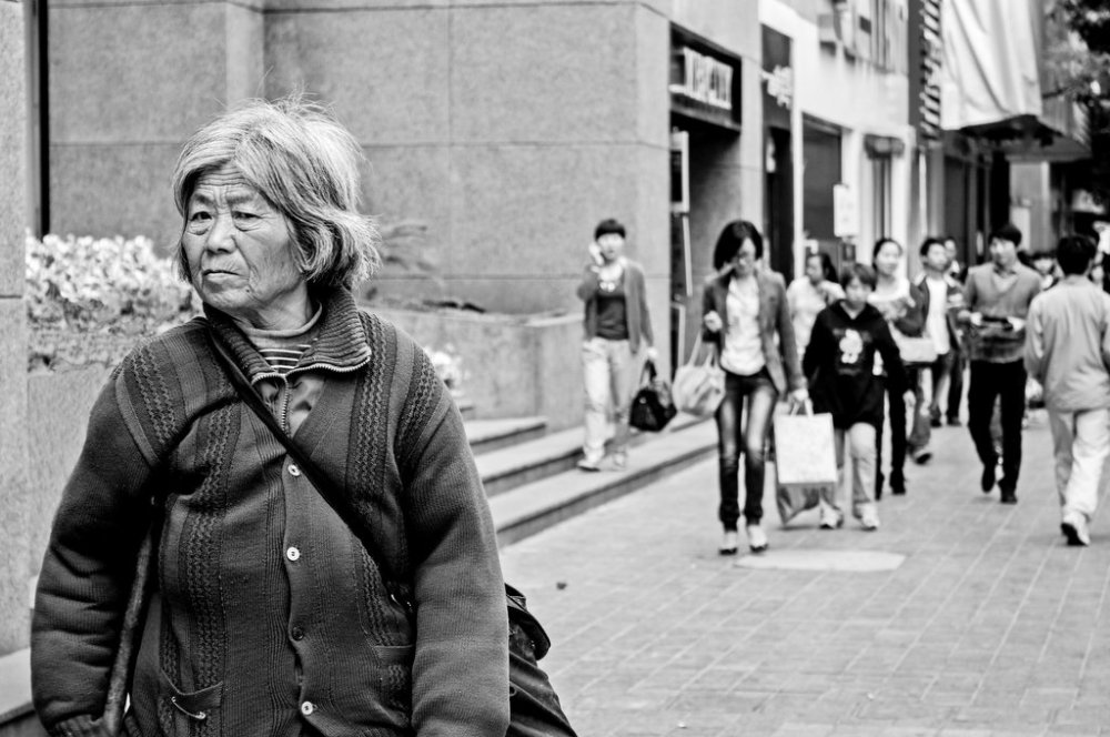 Poor lady walking in the city center