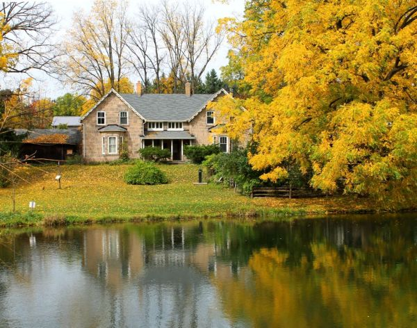 old house in milton fall  autumn colours pond