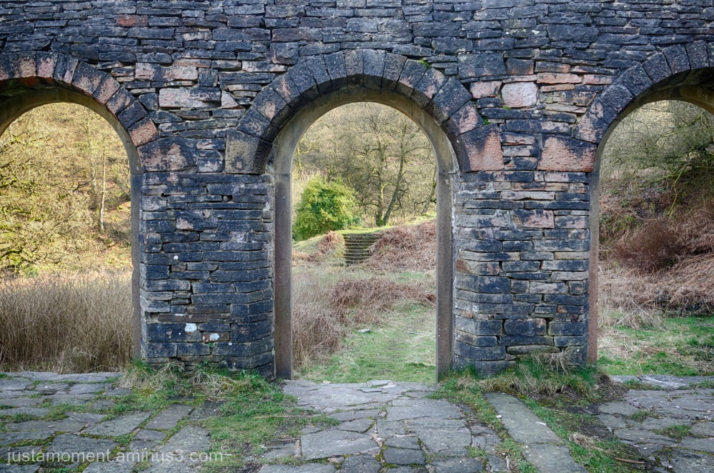 Through the arched window.