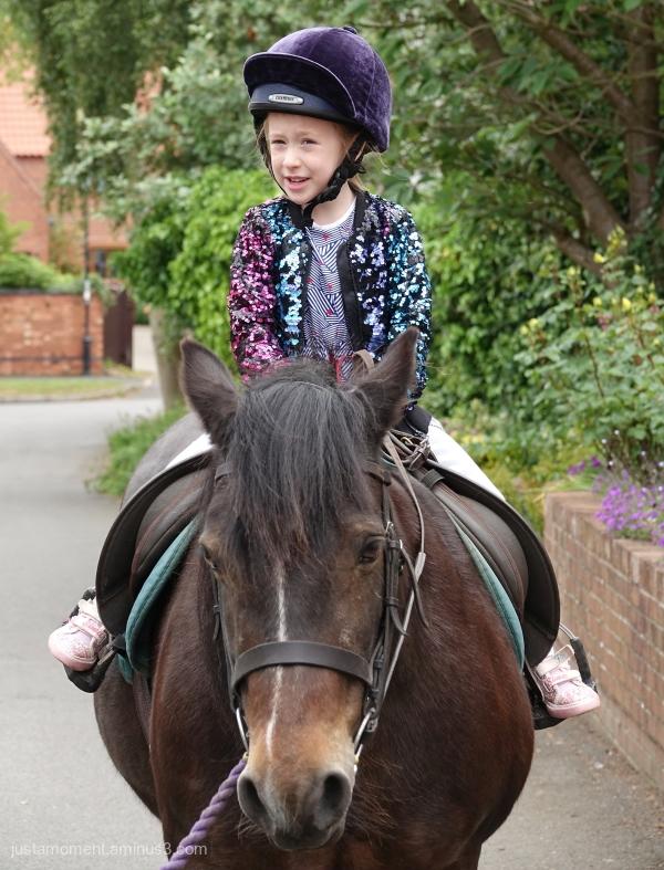 Lola riding Zoe.