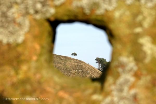 Through a hole in a rock.