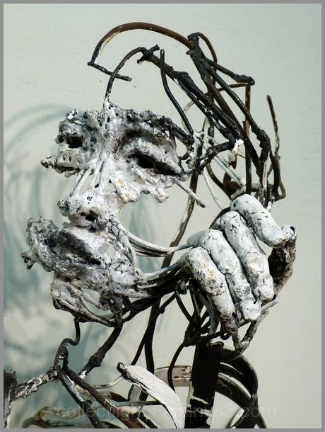 Hung sculpteur de fer, joue avec le feu 1/7