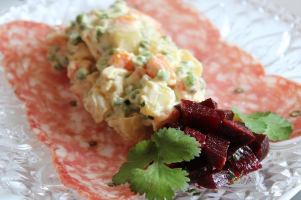 a potato salad in rosette sausage