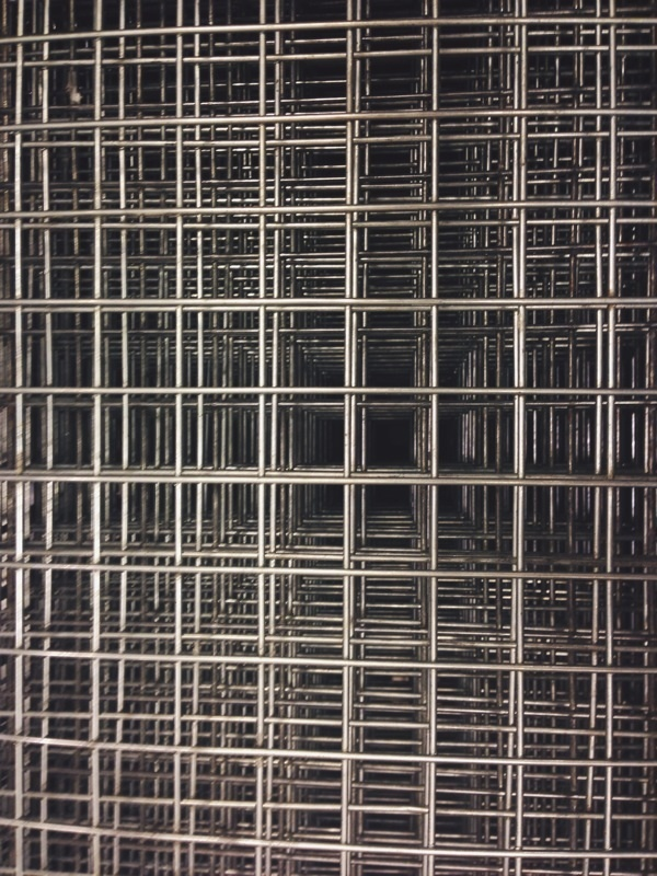 Untitled (stacked metal baskets)
