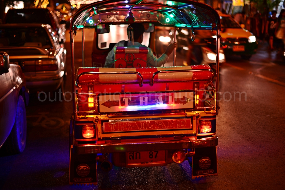 A tuk-tuk  emphasizing a true Asian culture