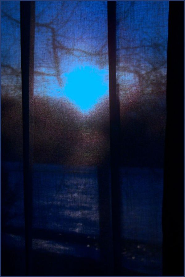blue curtain , sun