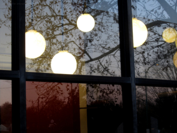 Floating lights in an urban neighborhood
