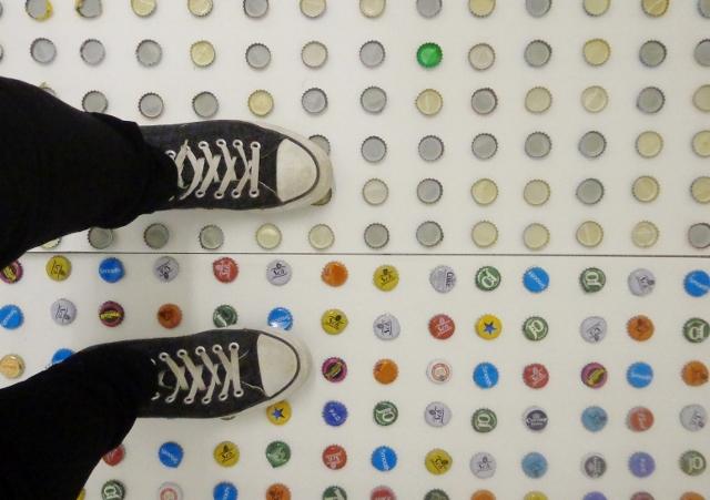 Walking on bottle caps