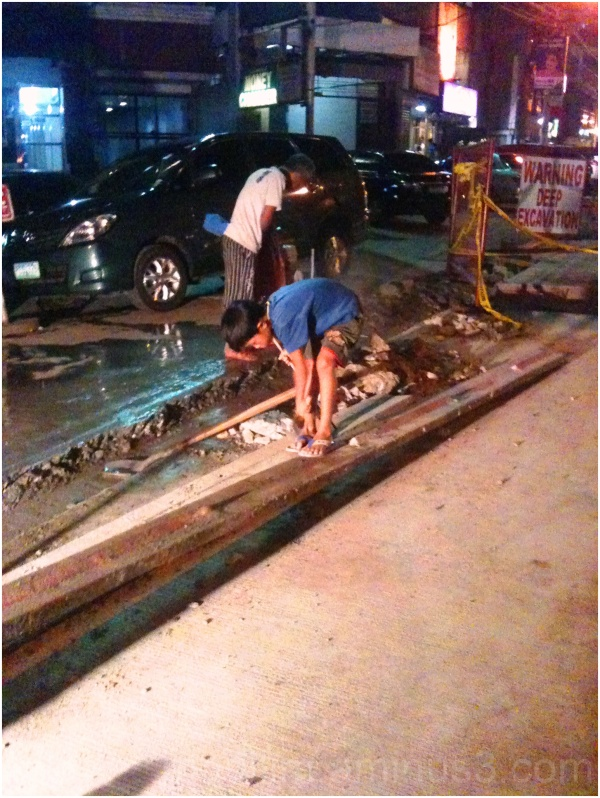 old man and boy road repair