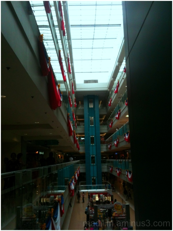 Philippine flag draping a mall