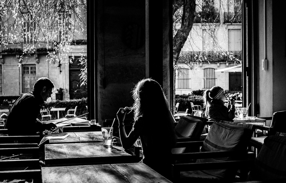 Sisters and man in a cafe.