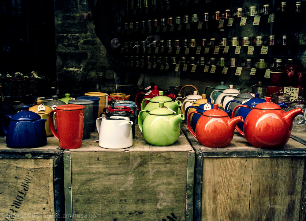 Colorful teapots in a store window.