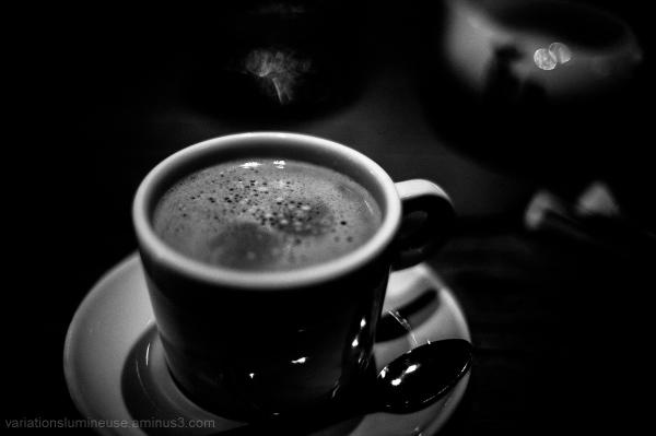 Full coffee mug on table.