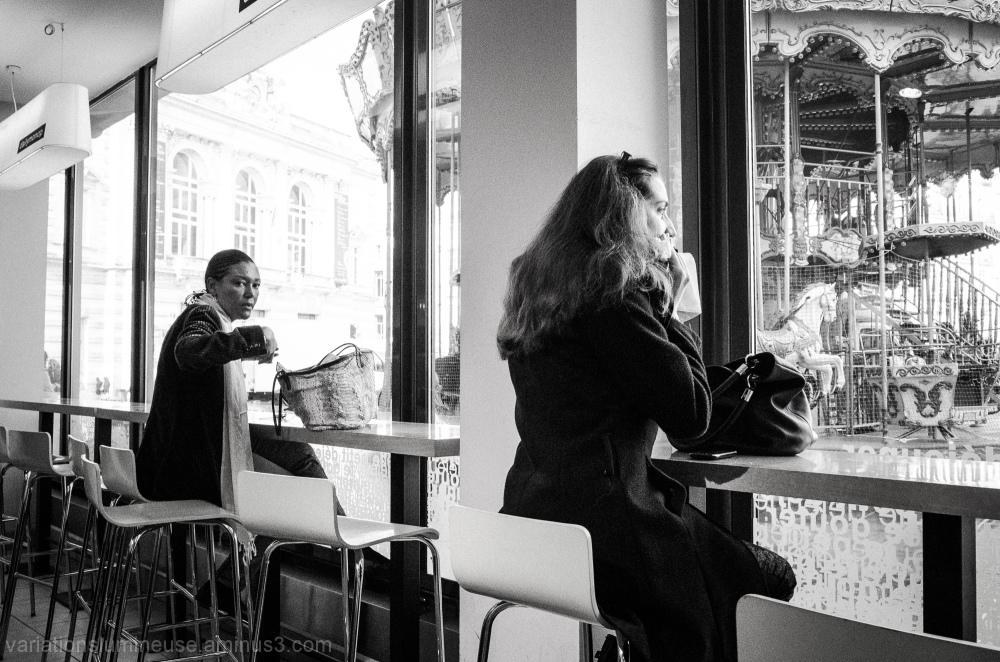 Two women having coffee before work.
