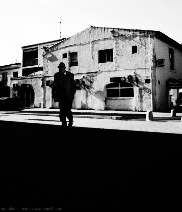 High contrast man walking in the street.