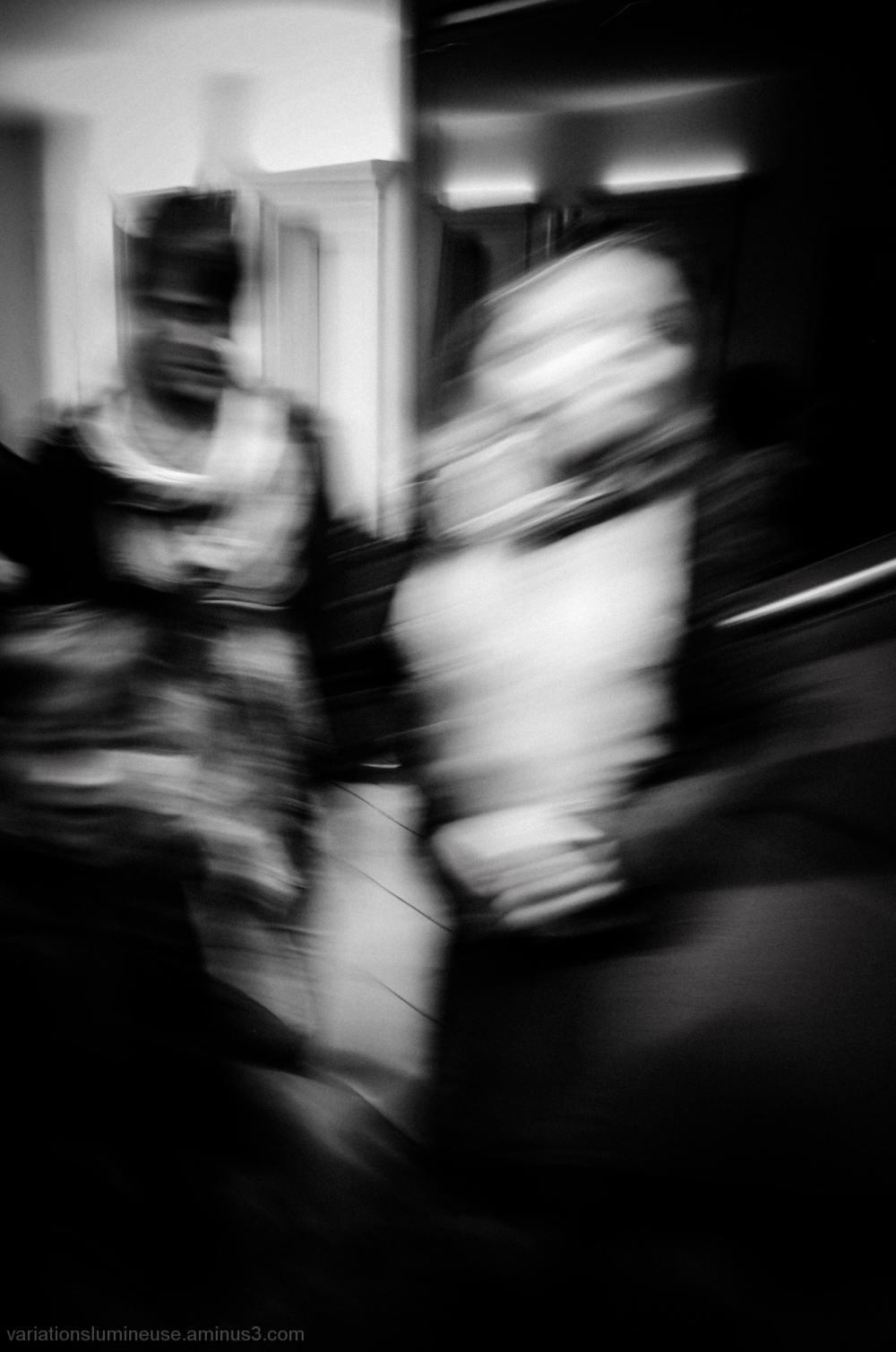 A couple blurred in the mall.