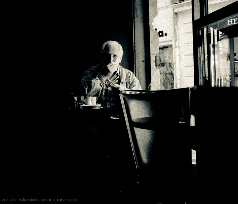 Older man at a cafe.