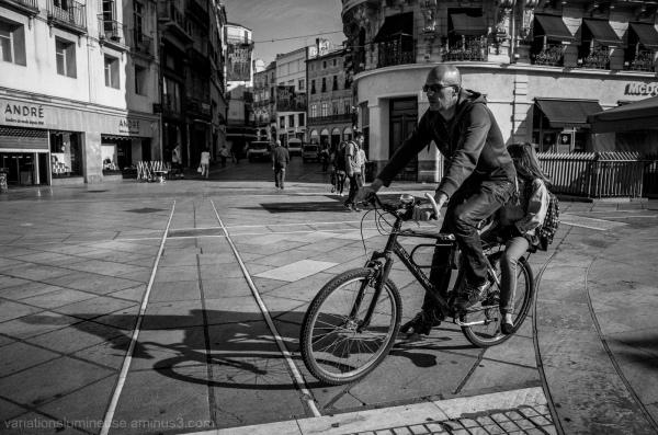 Man and girl on bike.