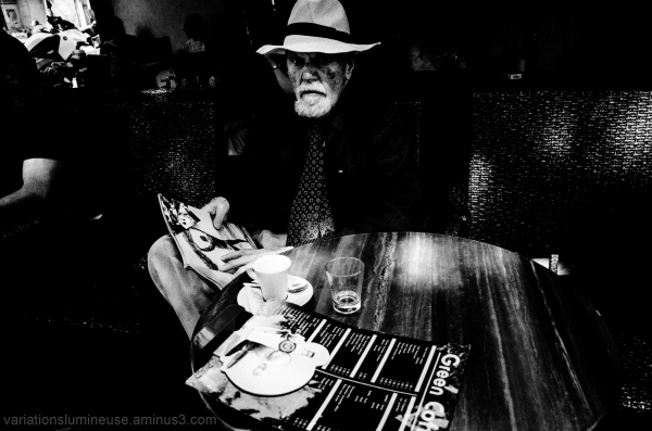 Man at outdoor cafe.