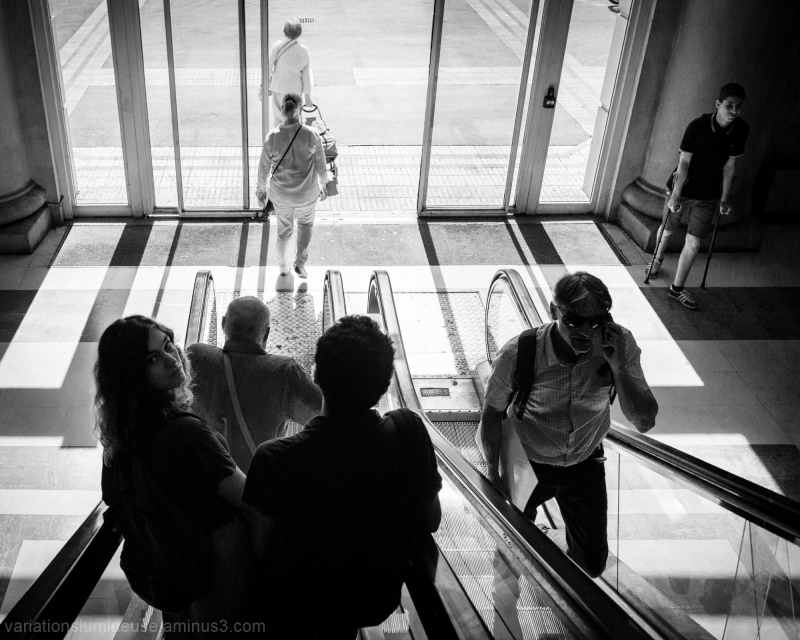 Woman turns on escalator to see me shoot.