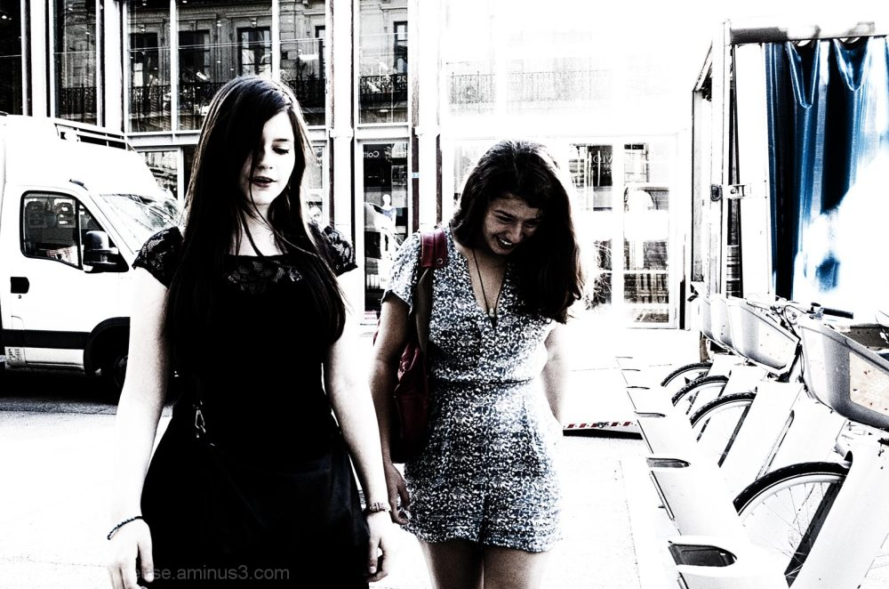 Two girls laughing together.