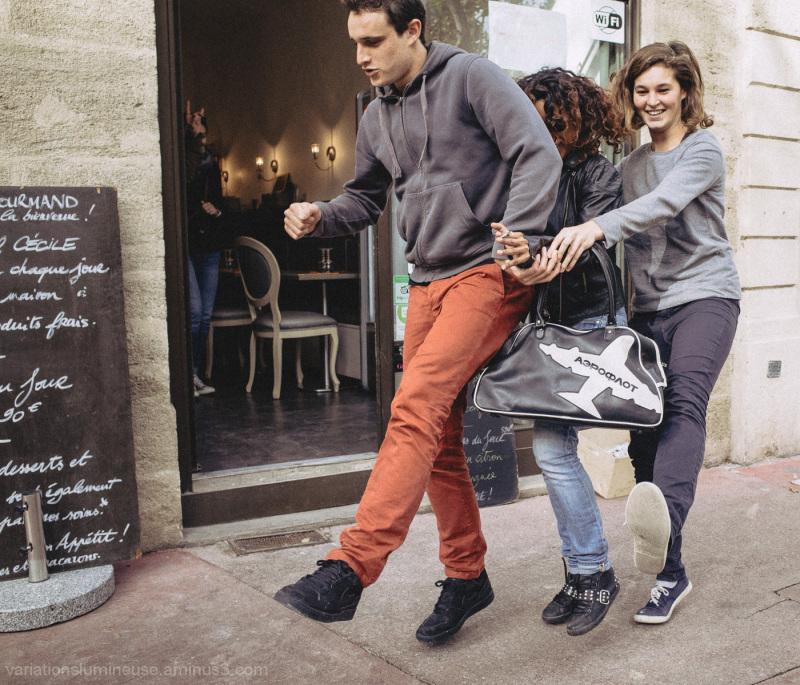 Teenagers dancing in the street.